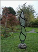 Vertical etched glass sculpture titled