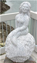 Medium-size stone sculpture of a mermaid sitting on a rock titled