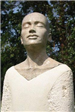 Stone sculpture of a bald person with eyes closed titled