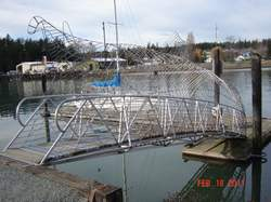 Metal foot bridge with fish images titled